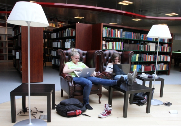 Two students writing a project together at Hjørring library.  Photo by: Per Drustrup Larsen